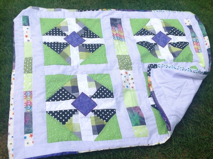 This quilt began as a gender neutral project, and became a gift for a wee baby boy.