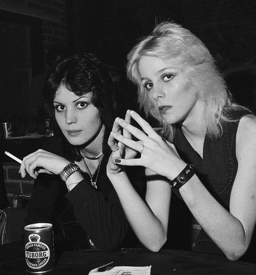 """Joan Jett and Cherie Currie chilling out backstage with a..."