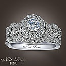 This is from Neil Lane's collection at Kay Jewelers. It's $2,349.99 without the wedding band pictured with the engagement ring here. It's a little blingy but it's pretty.