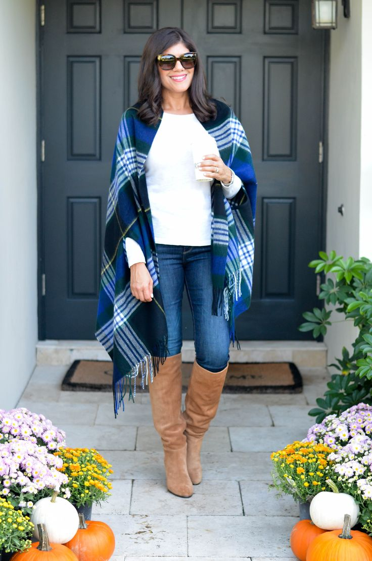 Lifestyle blogger Desiree of Beautifully Seaside styles a tartan plaid scarf cape from J.Crew and knee high suede boots for fall