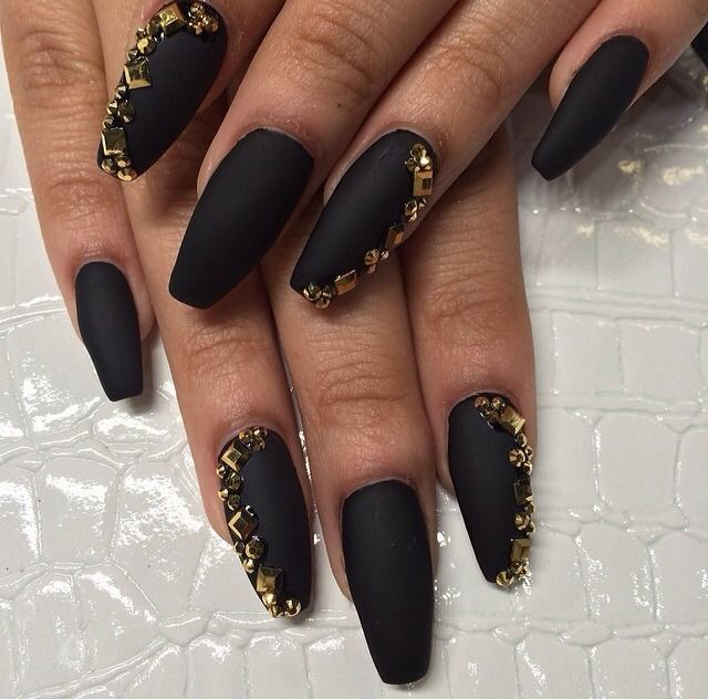 Gorgeous matte black stiletto nails with gold glitter