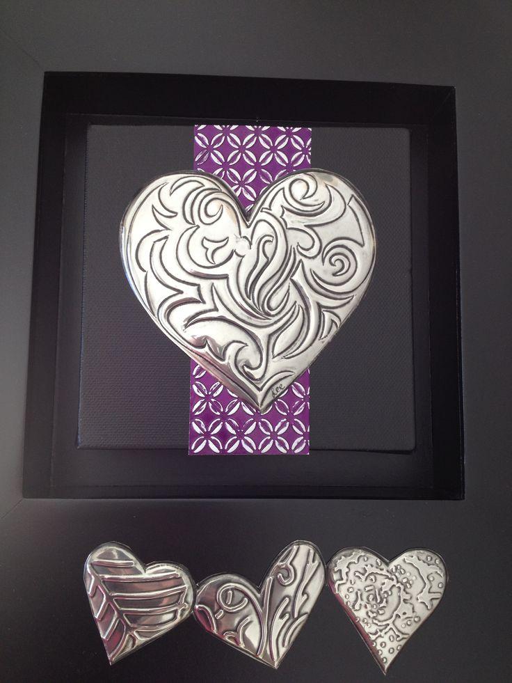 Box framed pewter hearts