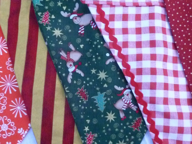 New product! Available to hire in 5 m lengths at £3.75/metre. Deluxe Christmas Bunting  The Deluxe Christmas Bunting is a bright and cheerful mixture of festive Christmas fabrics, handmade for you by The Vintage Bunting Hire Company. Six fabrics make up a deluxe sized bunting string, with fourteen pennants on a