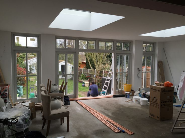 Current Project - Single storey rear extension amazing wooden external doors and large flat roof windows.