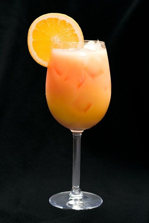 Orange champagne cocktail with champagne