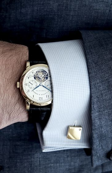 """Very nice..I actually stopped wearing my old watch because GQ said """"tanks"""" were in...slave that I am, but I still love my leather band Raymond Weil."""