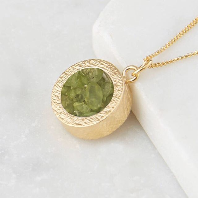 Our iconic Amulet pendant in this months birthstone - peridot. We can make a bespoke pendant for you with up to 4 birthstones inside. Carry your loved ones close to you or buy someone a super thoughtful gift. Shop via link in profile #personalized #jewellery #unique #gift #gold #rosegold #silver #british #designer #musthave