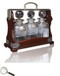 A Victorian Tantalus of Traditional Form with Three Cut Glass Decanters for SCOTCH, IRISH & ORANGE