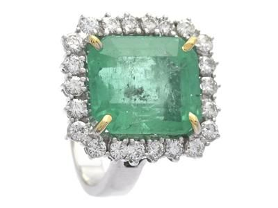 EMERALD RING, 18K white gold, emerald 9,54 cts, notches and inclusions, IGI certificate 239615717, enhanced transparency, 22 brilliant cut diamonds approx 0,88 ctw, approx W/VS-SI, abraded culets, 1 notch, size 17,75 mm, weight 10,1 g.