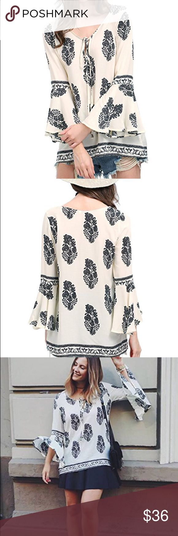 Lightweight blue & white bell sleeves blouse Brand new w tags lightweight blue and white floral printed 3/4 bell sleeves tunic blouse. Size small. 100% rayon, fabric has no stretch.  POSH RULES ONLY NO PP NO TRADES NO LOWBALL OFFERS  HAPPY POSHING! boutique Tops Blouses