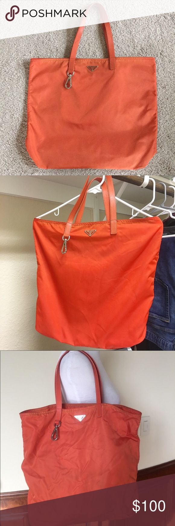 ***SALE***Authentic Orange Prada nylon tote bag It is already washed so it looks great than before i purchased it, it is big and easy to carry, still lots of life to give and very cute to carry as your to go bag, leather straps are in great condition, no flaws or holes, just the pen marks inside the bag and some bit of fading on the bottom base due to normal wear. pls review the photos and ask me anything about the bag before purchasing,  pls lower your expectation because this pretty bag is…