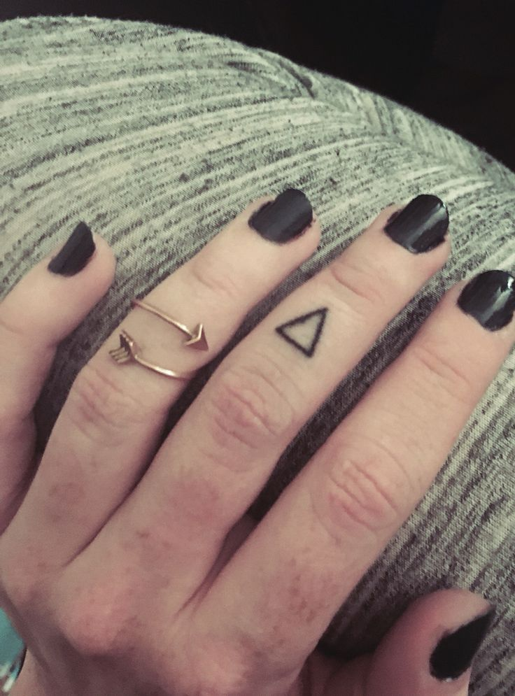 Simple Geometric glyph stick and poke finger tattoo