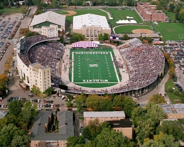 Dyche Stadium before the renovation, field lowering, turf replacement, etc. Purple tent represent!