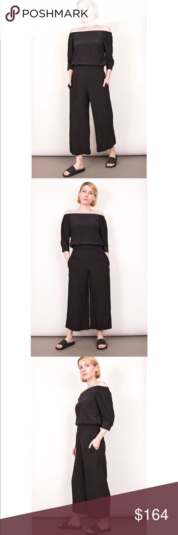 """Theory Faley black silk off the shoulder jumpsuit Theory """"Faley Mosaic"""" silk jumpsuit. Black off the shoulder with stretch waist detail. Side pockets. Minimalist cut. Wide leg crop ankle. Size 0 Model stands 5'4 for reference - Item photographed is of the item for sale  Sleeve-14 Bust-34 Waist-26 Rise-11 Inseam-22 Length-42 Theory Pants Jumpsuits & Rompers"""