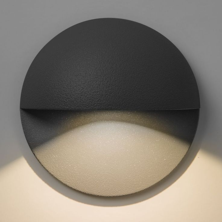 The Tivoli LED Wall Light Is An Exterior Finished In Black This