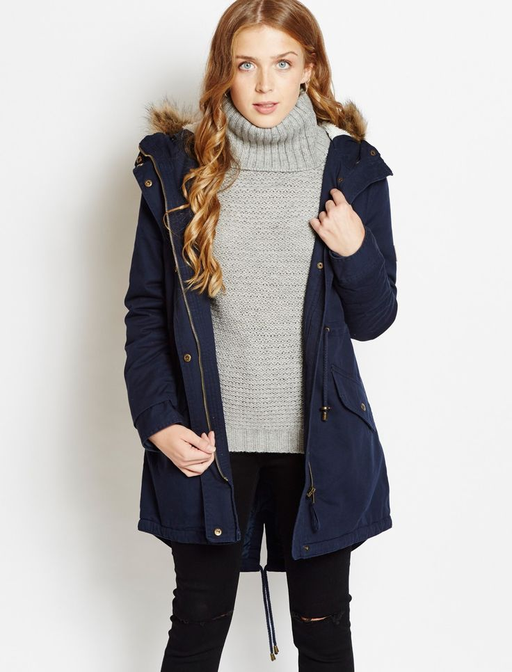 The fur trimmed Carolina with a classic fish tail hem will be your go to piece this winter. Treat yourself today with free shipping over £30.