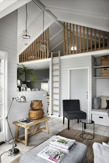Beautiful mezzanine living.  Loving the ladder and the crisp white trim