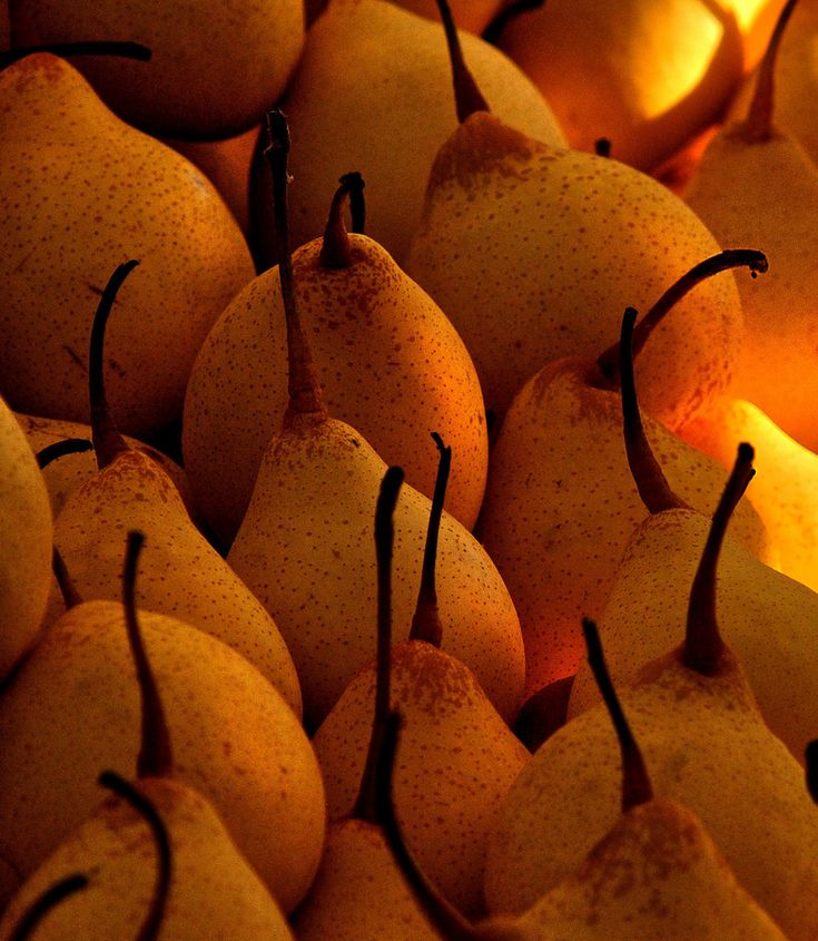 The color of these pears is quite stunning - they look delicious.