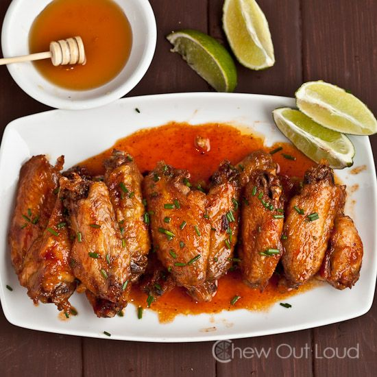 Honey Sriracha Chicken wings - These honey sriracha chicken wings are the perfect balance of sweet 'n spicy.•2 TB olive oil •3 lbs chicken wings, split, no tips •2 TB butter •1 TB garlic powder •1 tsp fresh ground black pepper •3 tsp kosher/coarse salt •For the Sauce: •5 TB butter •½ cup pure honey •¼ cup Sriracha (use less if you want it mild) •1 TB regular soy sauce •2 tsp freshly squeezed lime juice •lime wedges for garnish
