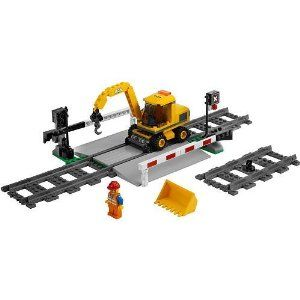 """LEGO City Set #7936 Level Crossing by LEGO. $79.99. Languages: French, English, Spanish. Product Weight: 0.86 Lb.. Educational Focus: Memory Skillls, Shapes and Colors. Manufacturer's Suggested Age: 5 Years and Up. Dimensions: 2.83 """" H x 7.52 """" W x 10.31 """" L. Number of Pieces: 142. Material: Plastic. Raise and lower the crossing gates and repair the tracks! Lower the crossing gates when a train comes by and then raise them again to let traffic pass over the level crossing. ..."""