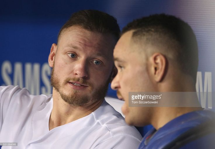 Josh Donaldson #20 of the Toronto Blue Jays talks to Russell Martin #55 in the dugout during MLB game action against the Texas Rangers on May 5, 2016 at Rogers Centre in Toronto, Ontario, Canada.