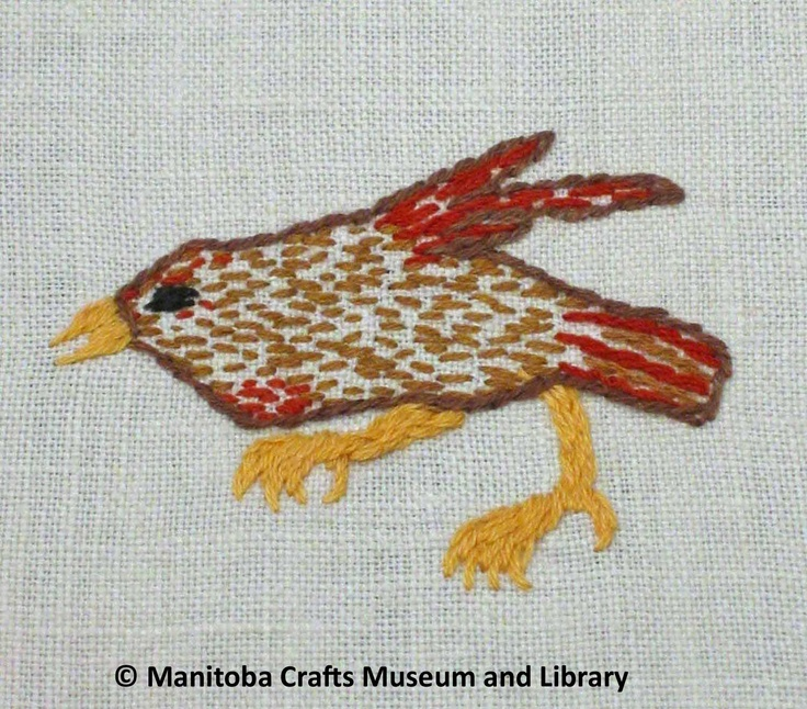 Detail: Embroidered bird motif, green scalloped edges.  Sitiches used are seed, back and satin.