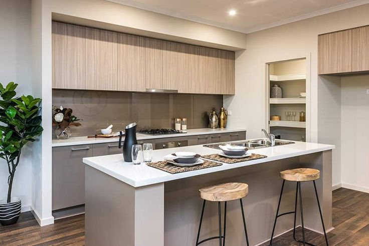 A stunning modern kitchen is the central heart of this lovely home. #weeksbuildinggroup #newhome #homedesign