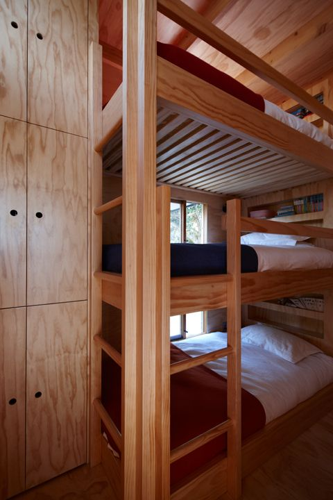 The house has a kitchen area, bathroom, master bedroom, and triple bunk beds for children and/or guests.