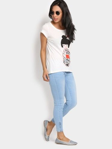 Say yes to this pair of washed jeans and team it with a white graphic print T-shirt. Add on a pair of blue ballerinas and teashades to emphasize the look.