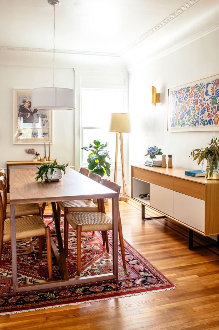 In the dining room, the table, chairs, and buffet are all from different sources (BluDot, 1stdibs, and DWR), but they all have the same vibe of Scandinavian minimalism.