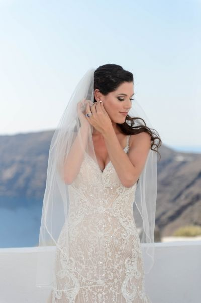 Capture from Dreamy Wedding at Santorini Gem by Phosart Photography & Cinematography