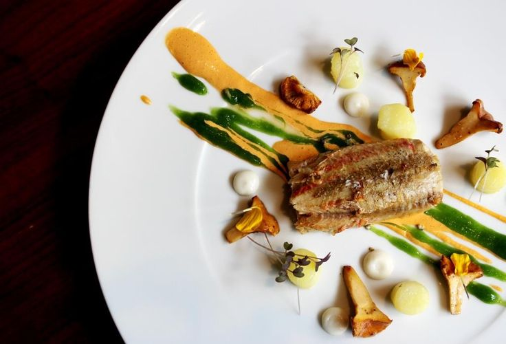 Pan roasted red mullet stuffed with chanterelle, mayonnaise of the fumet, almond milk and smoked potatoes
