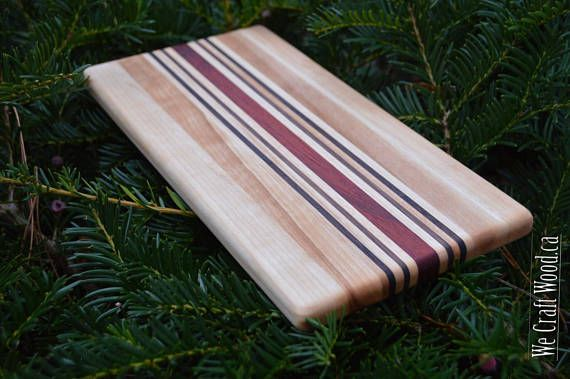 Our handcrafted cheeseboards are the perfect addition to any kitchen or bar!  Use it to cut up your favourite drink garnishes, or just enjoy some fruit and veggies. Create a tasty collection of cheeses, meats, crackers and savoury snacks.  Each board is hand finished with food-safe mineral oil and beeswax, and ready to use.