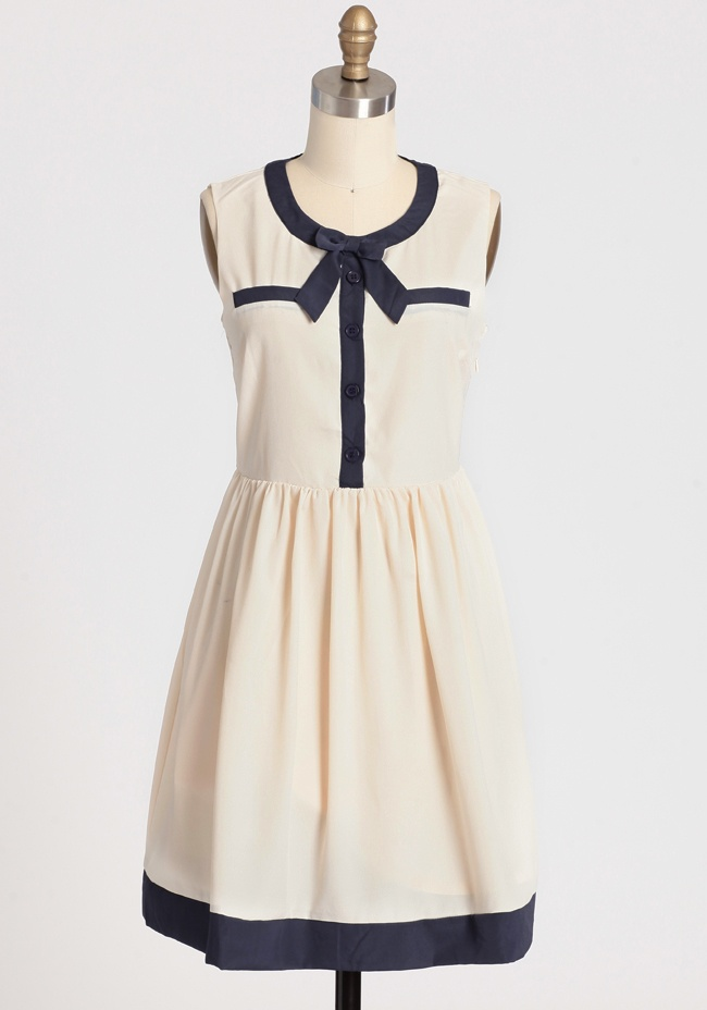 """""""Vintage-inspired with the perfect hint of nautical charm, this silky ivory dress is complemented with decorative front pockets, a darling bow accent, and front button closures."""": Sailors Dresses, Fashion Clothing, Ivory Dresses, Perfect Bows, Bows Dresses, Bridesmaid Pictures, Modern Vintage Dresses, Work Dresses, Pictures Perfect"""