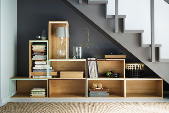 Use that space under the stairs for books and bric-a-brac, not boots.