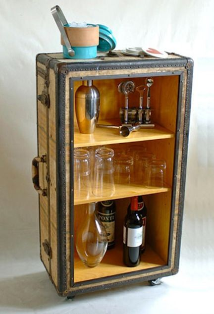This photo shows a vintage suitcase turned into a rolling bar cart, but I think I would fill mine with scrapbook and altered art supplies.
