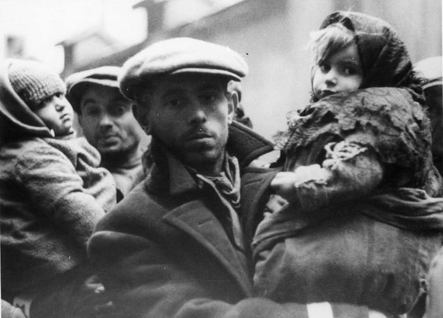 Warsaw, Poland, A man holding a girl.(Yad Vashem Photo Archive)