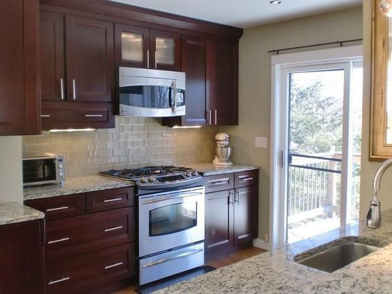 Modern Kitchen with African rainbow granite, picture window, Galley, Standard height, Paint, gas range, built-in microwave    prices given