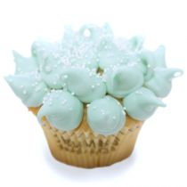 Jester Vanilla cake with light blue cream cheese frosting points sprinkled with nonpareils and white pearls.