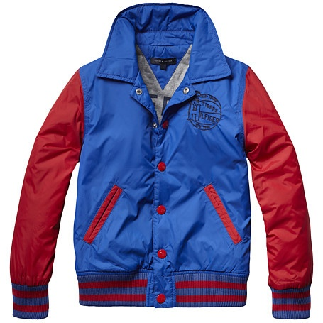 Go sporty with this lightly padded classic baseball jacket. Tommy Hilfiger embroidery on the chest. Ribbed neckline, cuffs and bottom hem with accent stripes emphasize the authentic baseball look. Branded metal snap buttons along the placket. Full jersey lining with large logo print.