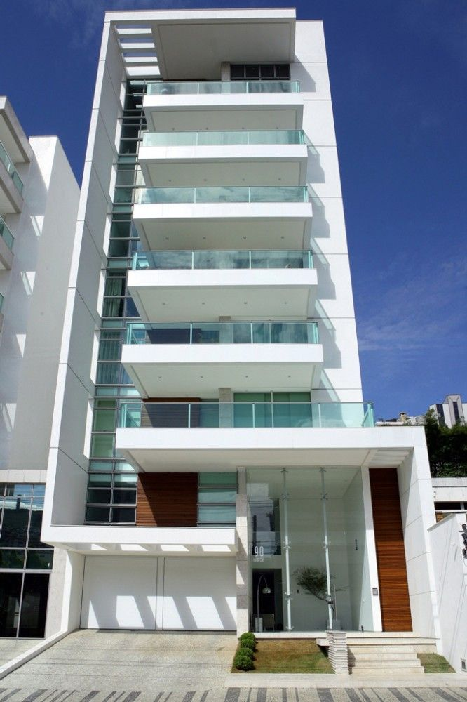 Interest: glasswork, extended white walls with balconies. Apartment concept.