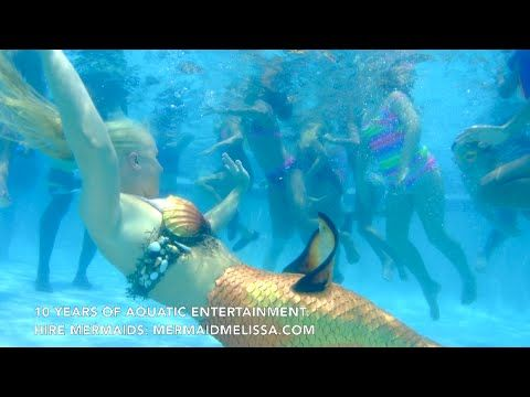 Live mermaid swimming with kids for pool party entertainment