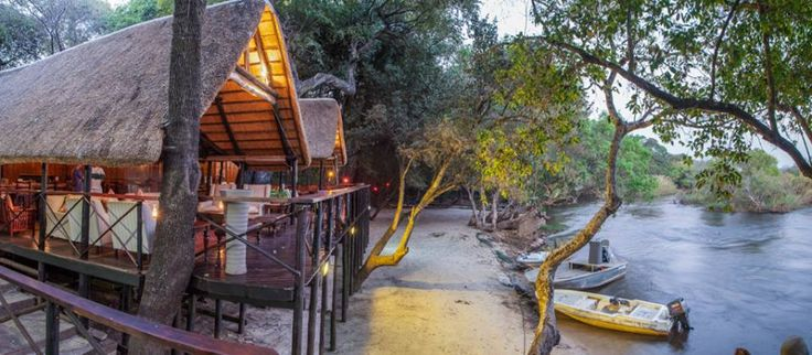 relax poolside underneath a riverine canopy at our secluded tented lodge, Stay 4 nights at Ichingo Chobe River Lodge with a complimentary day trip to Victoria Falls! #africa #safari #lodge #animals #river #canoe #VicFalls #VictoriaFalls #travel book with us now africamemoriestravel.com or email info@africamemoriestravel.com