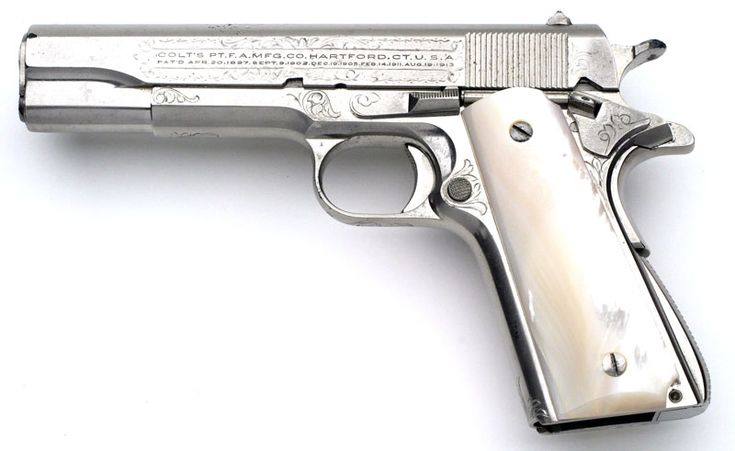 Colt Super .38 Factory Engraved, Factory Nickel Finish with Mother of Pearl stocks. One of 38 factory engraved pre-war Super .38 pistols.