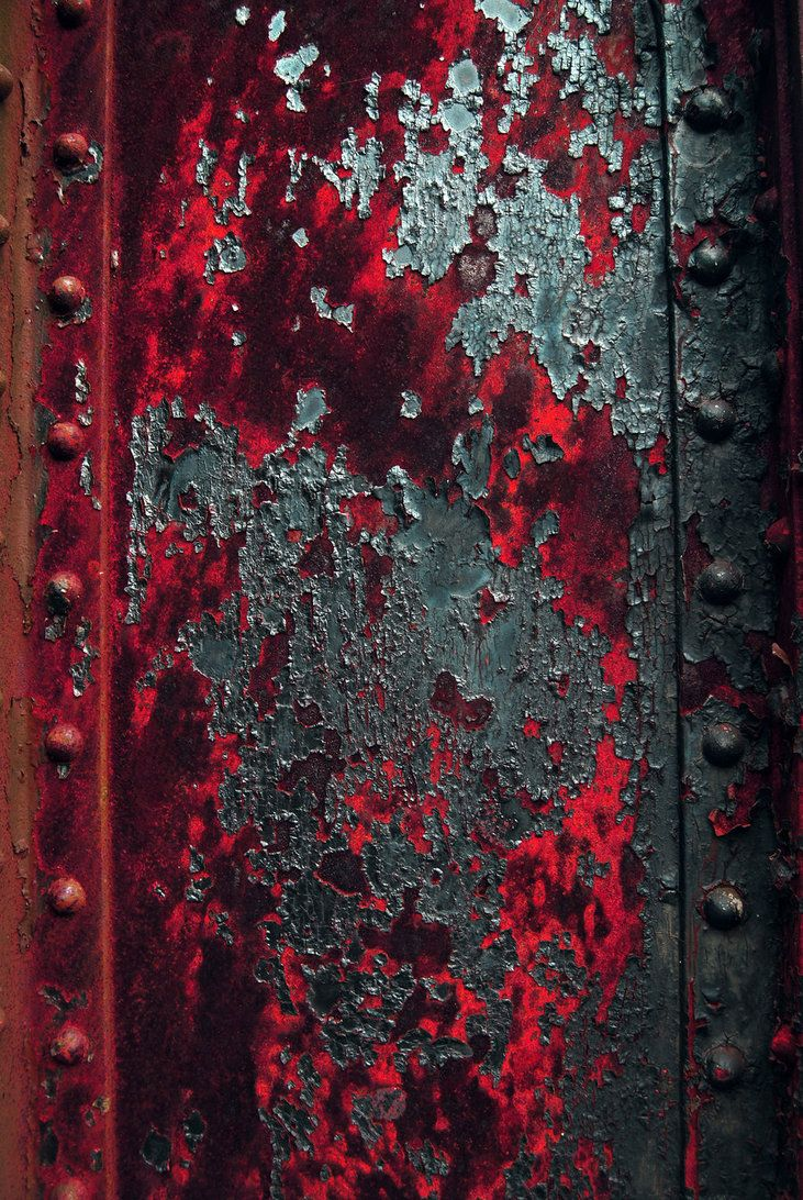 Rust Beam.  Photograph by D.T. Stephenson (Logicalx) on deviantART.  Deep red rust with blue and grey/silver tones.
