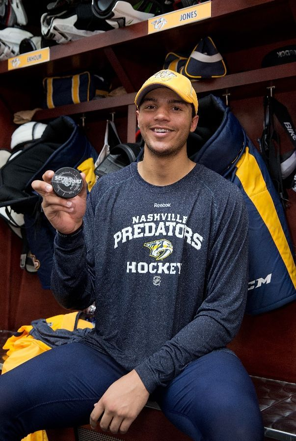 OCTOBER 12: Seth Jones #3 of the Nashville Predators holds his first NHL goal puck
