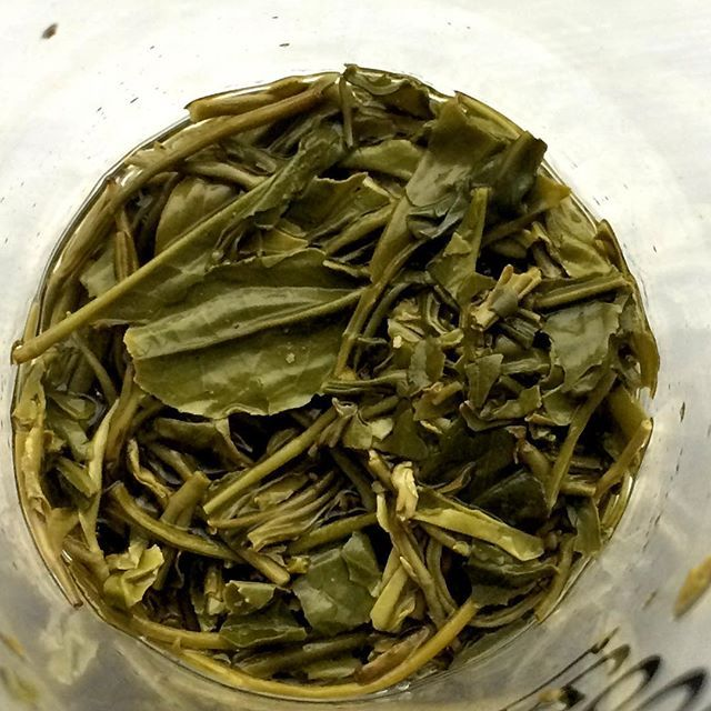 The remains of yesterday's tea, a Lu Shan Yun Wu. I infused it several times in a glass tumbler. #drinkingteawhiletraveling