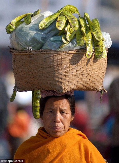 A woman vendor on her way with 'Yongchak' to Ima market.