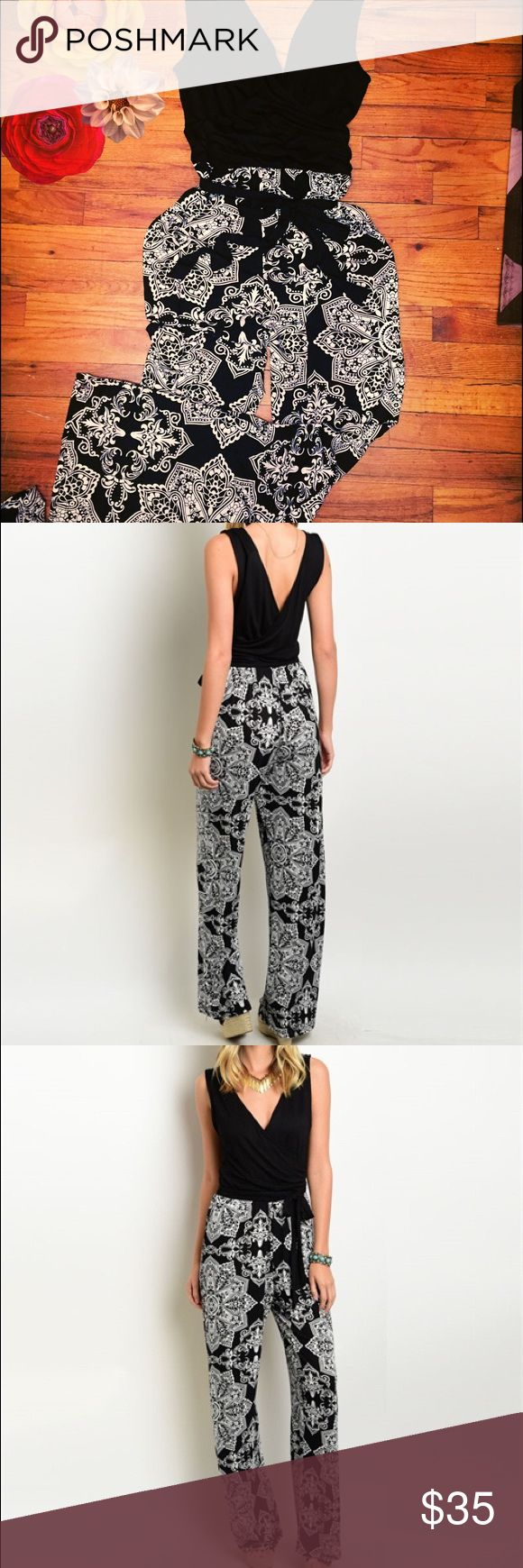 Paula Jumpsuit This gorgeous black and white designed jumpsuit is a comfy and fashionable. It features a plunging back and neckline and ties around the waist.    Fabric Content: 65% RAYON 35% VISCOSE Simply Jazzy boutique Pants Jumpsuits & Rompers