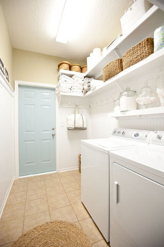 perfect shelving/storage beadboard in this simple laundry room - love the shallower shelf directly above the W/D and deeper open shelves above...also the hanging pegs.